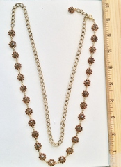 Dark topaz crystal flowers on gold chain