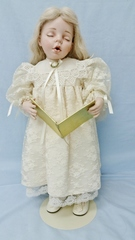 Caroler Angelica as a Dressed Doll